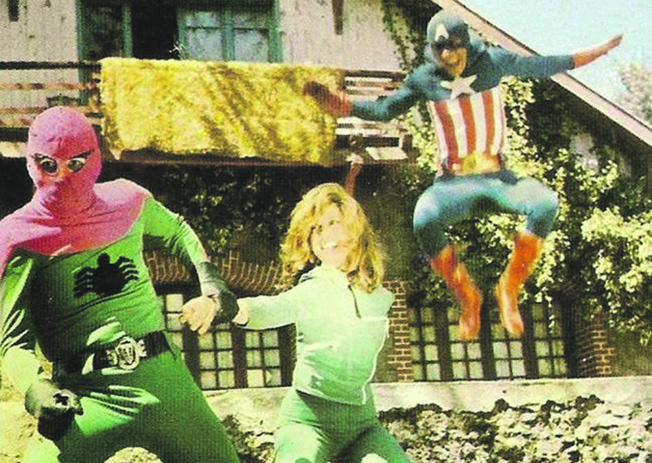 Photo from the movie '3 Dev Adam': Turkish Captain America is trying to save Julie from the Evil Turkish Spiderman.